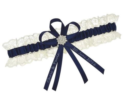 Jarretière bleu marine avec dentelle crème et fleur en strass.